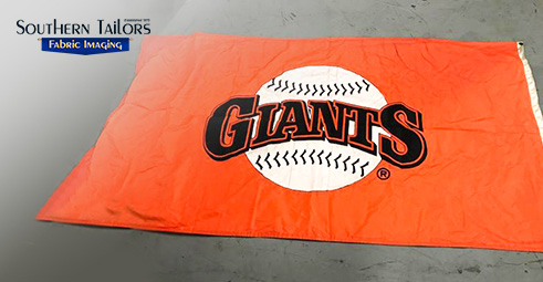 Picture of a Giants flag fabricated by Southern Tailors